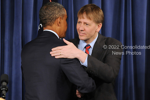 United States President Barack Obama (L) shakes hands with Richard Cordray (R) during a visit to the Consumer Financial Protection Bureau in Washington DC, USA, on 06 January 2012. Obama placed Richard Cordray as head of the Consumer Financial Protection Bureau with a recess appointment 04 January 2012. Republicans in the Senate had blocked Cordray's confirmation in December 2011..Credit: Michael Reynolds / Pool via CNP