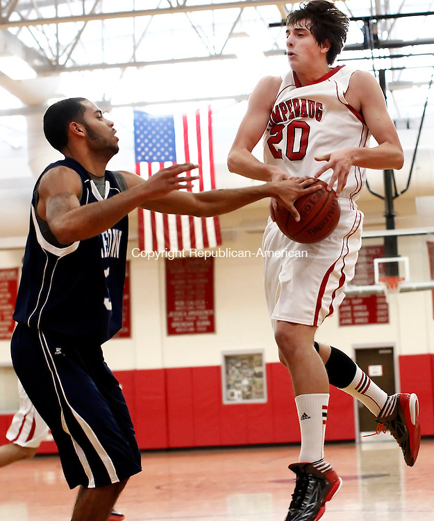 Southbury, CT- 26 January 2013-012613CM11-   Middletown's Andrew Campbell, left, strips the ball from Pomperaug's Lucien Fortier during boys basketball action against Middletown Saturday afternoon in Southbury.   Christopher Massa Republican-American