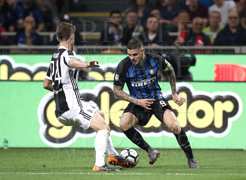 Calcio, Serie A: Inter - Juventus, Milano, stadio Giuseppe Meazza (San Siro), 28 aprile 2018.<br /> Inter's captains Mauro Icardi (r) in action with Juventu's Daniele Rugani (l) during the Italian Serie A football match between Inter Milan and Juventus at Giuseppe Meazza (San Siro) stadium, April 28, 2018.<br /> UPDATE IMAGES PRESS/Isabella Bonotto