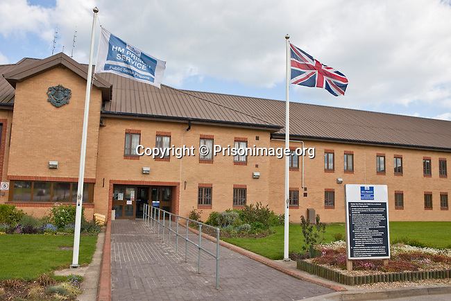 The main entrance to HMP & YOI Littlehey. Littlehey is a purpose build category C prison.
