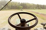 April 20, 2016. Rowland, North Carolina. <br />  A few from Bo Stone's tractor before it gets started planting a corn field. <br />  Bo Stone, age 44, runs a 2300 acre farm near the South Carolina border. After 5 generations of tobacco farming, Stone helped to move his family farm over to corn, wheat, soybeans, and strawberries 7 years ago. <br />  While his corn crop is entirely made up of stacked genetically modified strains of corn, Stone says he chose the varieties primarily for their yield characteristics, but having the ability to utilize their herbicide tolerant traits if a weed gets out of control is &quot;another tool in my toolbox&quot;.