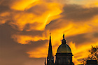 January 4, 2019; The Dome and Basilica steeple silhouetted by the sunset. (Photo by Matt Cashore)