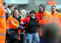 ATTENTION SPORTS PICTURE DESK<br /> Pictured: A female Swansea supporter (C) is detained by security staff<br /> Re: npower Championship Swansea City FC v Cardiff City FC at the Liberty Stadium, south Wales. Sunday 06 February 2011