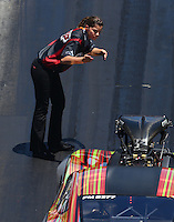 Jun 18, 2016; Bristol, TN, USA; Cassie Simonton , crew member for NHRA pro mod driver Von Smith during qualifying for the Thunder Valley Nationals at Bristol Dragway. Mandatory Credit: Mark J. Rebilas-USA TODAY Sports