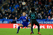 18th March 2018, King Power Stadium, Leicester, England; FA Cup football, quarter final, Leicester City versus Chelsea; Harry Maguire of Leicester City heads the ball away from Willian of Chelsea