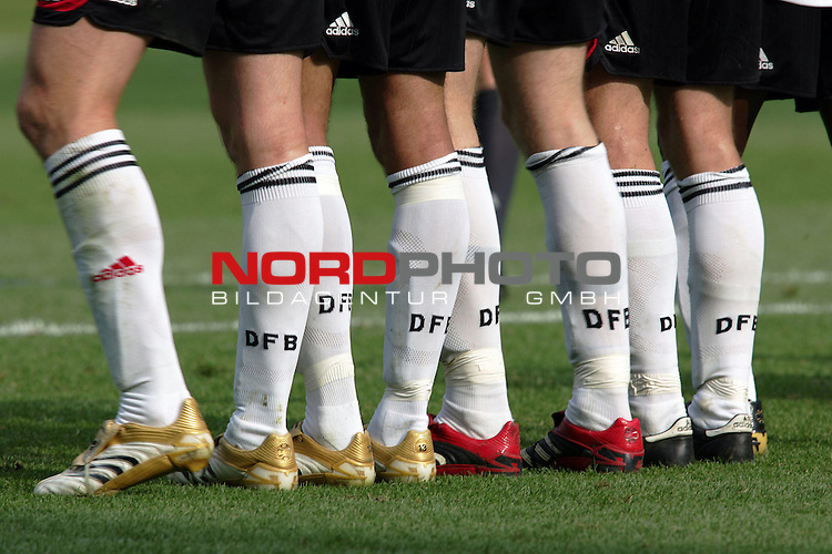 FIFA WM 2006 - Gruppe A ( Group A )<br /> <br /> Play #33 (20-Jun) - Ecuador vs Germany.<br /> <br /> The legs of the players from Germany during the match of the World Cup in Berlin, which they won by 3-0.<br /> <br /> Foto &copy; nordphoto
