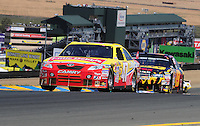 Jun. 21, 2009; Sonoma, CA, USA; NASCAR Sprint Cup Series driver Marcos Ambrose (47) leads Elliott Sadler (19) during the SaveMart 350 at Infineon Raceway. Mandatory Credit: Mark J. Rebilas-