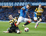 Fraser Aird of Rangers gets tackled by East Fife's Craig Johnstone