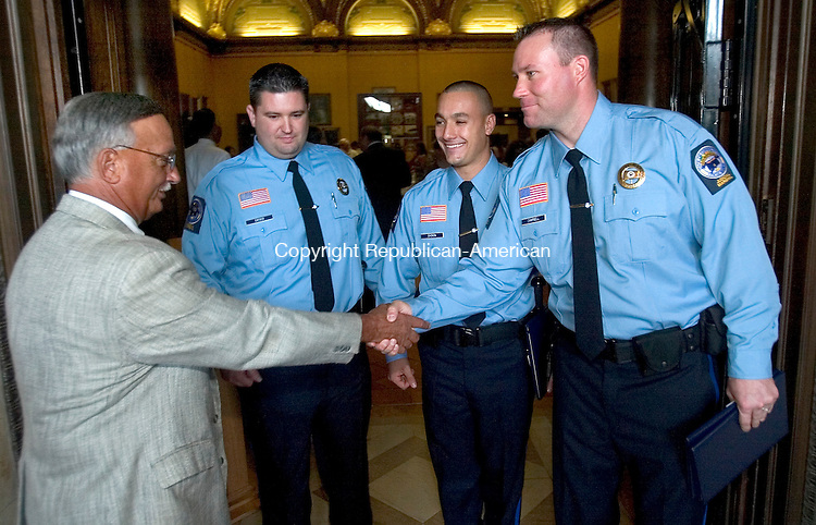 HARTFORD, CT. 14 August 2008-081408SV08--From left, Chief Marshal Anthony Candido of Waterbury congratulates 3 new Judicial Marshals Bruce Ciesco of Torrington, Matthew Gagnon of Thomaston and Kyle Campbell of Torrington that will be assigned to him in Waterbury. The three were in Hartford graduating with a new class of 22 Judicial Marshals at the State Library in Hartford Thursday.<br /> Steven Valenti Republican-American