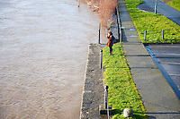 Thursday 02 January 2014<br /> Pictured:A girl photographs the River Towy in flood <br /> Re: The river that flows through the centre of Carmarthen has burst its banks after the recent bout of heavy rain.