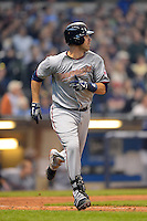 Minnesota Twins catcher Joe Mauer #7 watches a home run during a game against the Milwaukee Brewers at Miller Park on May 27, 2013 in Milwaukee, Wisconsin.  Minnesota defeated Milwaukee 6-3.  (Mike Janes/Four Seam Images)