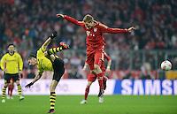 FUSSBALL   1. BUNDESLIGA  SAISON 2012/2013   15. Spieltag FC Bayern Muenchen - Borussia Dortmund     01.12.2012 Holger Badstuber (Mitte, FC Bayern Muenchen) gegen Robert Lewandowski (li, Borussia Dortmund)