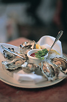 a platter of oysters in a restaurant in Rodeo Drive, LA