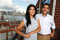 NEW JERSEY - FEATURES/REAL ESTATE:  Married couple Alman Shibli, 30, and Radhika Kapoor, 29, at home in their one bedroom apartment in the Maxwell Place on the Hudson complex, Hoboken, NJ, Sunday, August 23, 2015.<br /> <br /> PICTURED:   On their balcony with a NYC skyline view.<br /> <br /> (Angel Chevrestt, 646.314.3206)