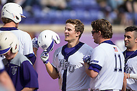 Carson Jackson (10) of the High Point Panthers is congratulated by his teammates after hitting a home run against the NJIT Highlanders during game one of a double-header at Williard Stadium on February 18, 2017 in High Point, North Carolina.  The Panthers defeated the Highlanders 11-0.  (Brian Westerholt/Four Seam Images)