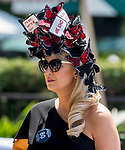 ELMONT, NY - JUNE 09: A woman wears a fancy headpiece with her picks for the races during Belmont Stakes Day at Belmont Park on June 9, 2018 in Elmont, New York. (Photo by Scott Serio/Eclipse Sportswire/Getty Images)