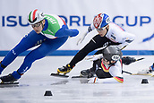 01 February 2019, Saxony, Dresden: Shorttrack: World Cup, quarter finals, 1500 meter men in the EnergieVerbund Arena. Tobias Pietzsch (below) from Germany falls behind Gun Woo Kim (r) from Korea and Andrea Cassinelli (l) from Italy.