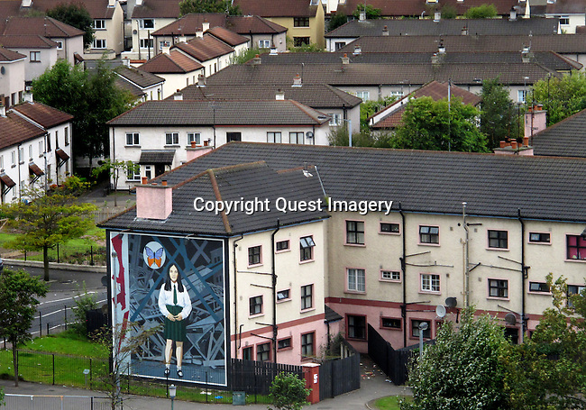&quot;The Death of Innocence&quot;,  a mural depicting Annette McGavigan, a 14 year-old schoolgirl killed in 1971 during the early years of &quot;The Troubles&quot; displayed on the side of an apartment complex called the Rossville Flats  in the Bogside, a neighborhood outside the city walls of Derry, Northern Ireland.<br /> <br /> This mural is part of a series called &quot;The People's Gallery&quot; by the Bogside Artists  depicting all who were killed by the British Army during &quot;The Troubles&quot;  in the Bogside.<br /> <br /> The Bogside Artists are a trio of mural painters from Derry, Northern Ireland, consisting of Tom Kelly, his brother William Kelly, and Kevin Hasson. &quot;The People's Gallery&quot; series is their most famous murals.<br /> <br /> The area has been a focus point for many of the events of &quot;The Troubles&quot;, from the Battle of the Bogside and Bloody Sunday in the 1960s and 1970s.<br /> <br /> The Troubles was a period of ethno-political conflict in Northern Ireland which spilled over at various times into England, the Republic of Ireland, and mainland Europe. The duration of the Troubles is conventionally dated from the late 1960s and considered by many to have ended with the Belfast &quot;Good Friday&quot; Agreement of 1998.<br /> <br /> Derry or Londonderry is the second-biggest city in Northern Ireland.  The old walled city lies on the west bank of the River Foyle, which is spanned by two road bridges and one footbridge. Photo by Deirdre Hamill/Quest Imagery