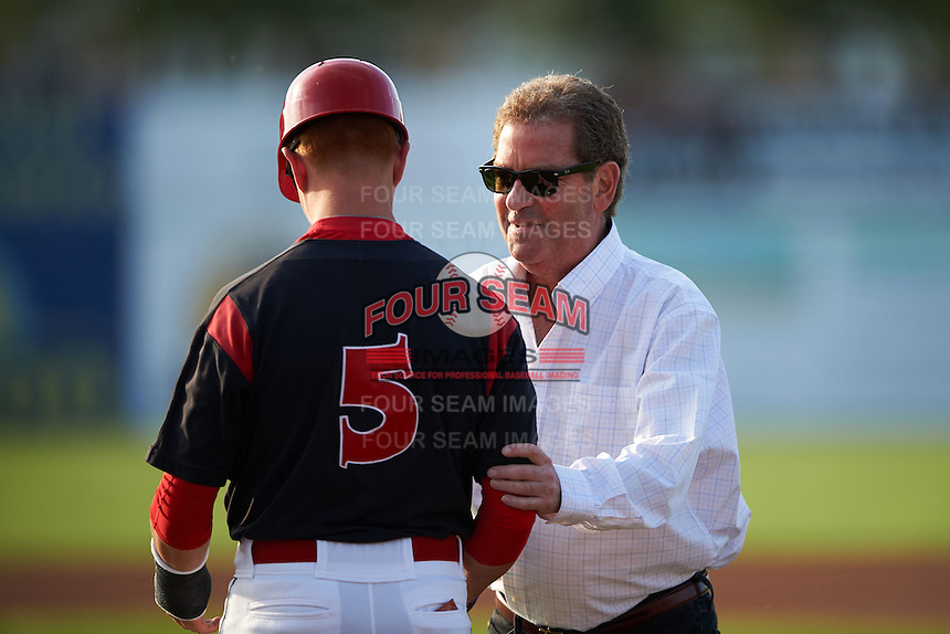 Actor Hiram Kasten shakes hands with Kyle Barrett (5) after throwing out the ceremonial first pitch before a Batavia Muckdogs game against the Auburn Doubledays July 10, 2015 at Dwyer Stadium in Batavia, New York.  Auburn defeated Batavia 13-1.  (Mike Janes/Four Seam Images)