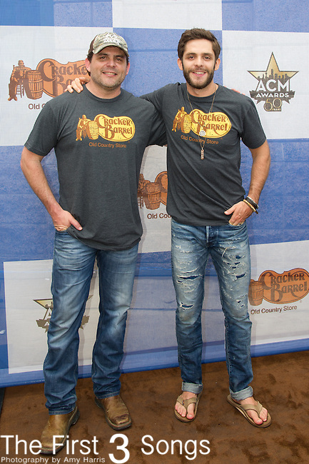 Rhett Akins, Thomas Rhett attends the Cracker Barrel Old Country Store Country Checkers Challenge at Globe Life Park in Arlington on April 18, 2015 in Arlington, Texas