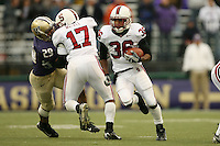 11 November 2006: Chris Hobbs passes a block by Carlos McFall during Stanford's 20-3 win over the Washington Huskies in Seattle, WA.