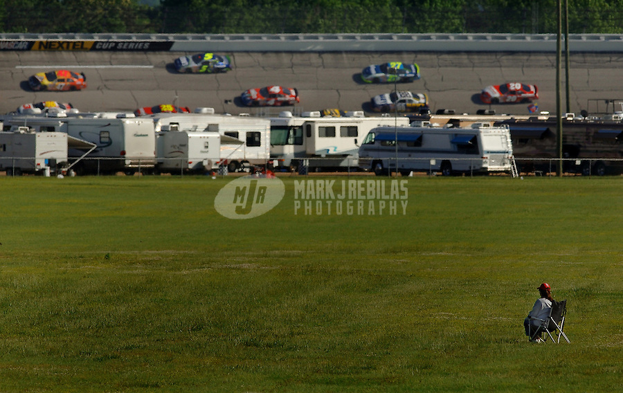 Apr 27, 2006; Talladega, AL, USA; A lone fan watches Nascar Busch Series cars race from the infield during practice for the Aarons 312 at Talladega Superspeedway. Mandatory Credit: Mark J. Rebilas