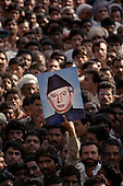 Punjab, Pakistan<br /> November 11, 1988<br /> <br /> The images of Ali Bhutto, Benazir's father and former Prime Minister, is displayed at a Bhutto campaign rally.<br /> <br /> Bhutto, the eldest child of former Pakistan President and Prime Minister Zulfikar Ali Bhutto, found herself placed under house arrestin the wake of her father's imprisonment and subsequent execution in 1979. In 1984 she became the leader in exile of the Pakistan Peoples Party (PPP), her father's party, though she was unable to make her political presence felt in Pakistan until after the death of General Muhammad Zia-ul-Haq. <br /> <br /> On 16 November 1988 Benazir's PPP won the largest bloc of seats in the National Assembly. Bhutto was sworn in as Prime Minister in December, at age 35 she became the first woman to head the government of a Muslim-majority state in modern times. <br /> <br /> She was removed from office 20 months later under orders of then-president Ghulam Ishaq Khan for alleged corruption. Bhutto was re-elected in 1993 but was again removed by President Farooq Leghari in 1996, on similar charges. Bhutto went into self-imposed exile in Dubai in 1998, until she returned to Pakistan on October 2007, after General Musharraf granted her amnesty and all corruption charges withdrawn.