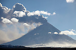 Eruption of Kliuchevskoi (Klyuchevskoy) Volcano, Kamchatka, Russia showing ash and steam clouds being blown away by wind.