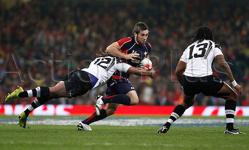 19.11.2010 International Rugby Union from the Millennium Stadium in Cardiff. Wales v Fiji. Andrew Bishop of Wales is tackled by Gabi Lovobalavu of Fiji.