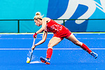 Georgie Twigg #7 of Great Britain passes the ball during Argentina vs Great Britain in women's Pool B game  at the Rio 2016 Olympics at the Olympic Hockey Centre in Rio de Janeiro, Brazil.