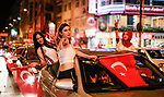 A picture taken on June 24, 2018 shows Supporters of Turkish President Recep Tayyip Erdogan celebrate the results of the Turkish presidential and parliamentary elections, in Istanbul, Turkey. Photo by Shady al-Assar