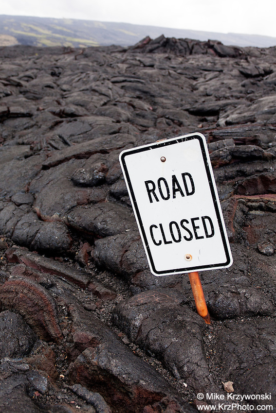 """Road Closed"" sign emerging from lava field, Hawaii Volcanoes National Park, Big Island, Hawaii"