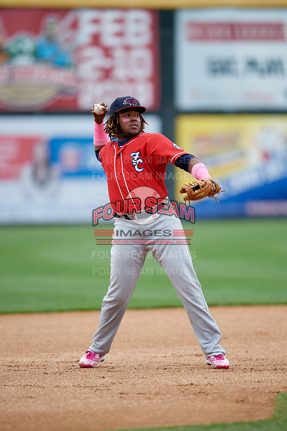 New Hampshire Fisher Cats third baseman Vladimir Guerrero Jr. (27) throws to first base during the first game of a doubleheader against the Harrisburg Senators on May 13, 2018 at FNB Field in Harrisburg, Pennsylvania.  New Hampshire defeated Harrisburg 6-1.  (Mike Janes/Four Seam Images)
