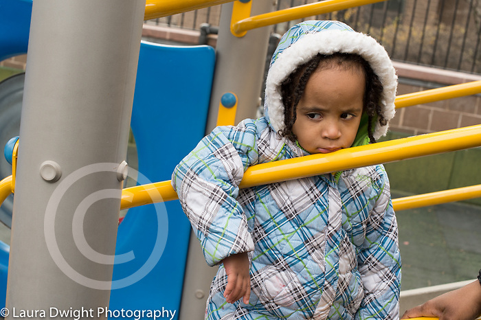 Education Preschool 3 year olds sad unhappy girl on playground