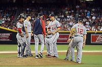 Washington Nationals manager Davey Johnson (5) makes a pitching change during his last game, announcing his retirement, against the Arizona Diamondbacks with catcher Jhonatan Solano (23), Anthony Rendon (6), Zach Walters (4), Xavier Cedeno (64) Steve Lombardozzi (1 - hidden) and Tyler Moore (12) at Chase Field on September 29, 2013 in Phoenix, Arizona.  Arizona defeated Washington 3-2.  (Mike Janes/Four Seam Images)