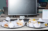 "Food rests on a table at the Metric Geometry and Gerrymandering Group (MGGG) hackathon at the Data Lab in the Tisch Library at Tufts University in Medford, Massachusetts, USA, on Thurs., Aug. 10, 2017. Justin Solomon, organizer of the hackathon and an Assistant Professor in MIT's Computer Science and Artificial Intelligence Laboratory (CSAIL) and Department of Electrical Engineering and Computer Science (EECS), said part of his job is ""to make sure that [the participants] are well fed and well caffeinated.""  The hackathon is part of the first in a series of Geometry of Redistricting workshops put on by the MGGG. Academics, Geographic Information Systems (GIS) professionals, and legal professionals worked together to build tools useful in analyzing voting district data around the country."