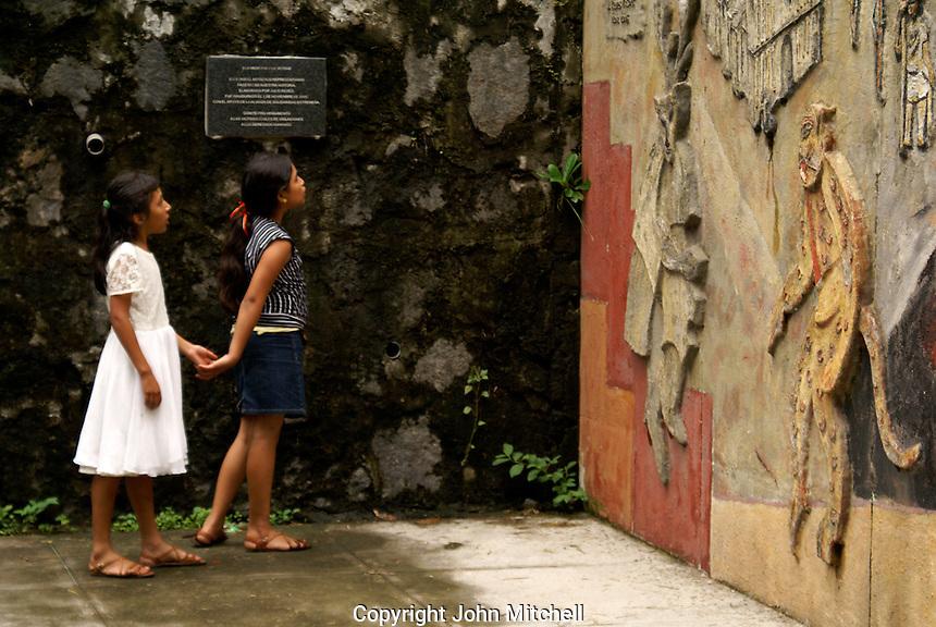 Two children looking at the Monumento a la Memoria y la Verdad or Monument to Memory and Truth in Parque Cuscatlan, San Salvador, El Salvador