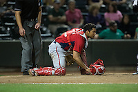 Potomac Nationals catcher Raudy Read (21) checks the runner at second base after blocking a pitch in the dirt during the game against the Winston-Salem Dash at BB&T Ballpark on May 13, 2016 in Winston-Salem, North Carolina.  The Dash defeated the Nationals 5-4 in 11 innings.  (Brian Westerholt/Four Seam Images)