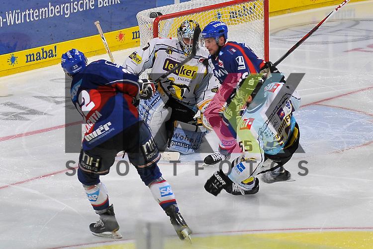 Mannheims Matthias Plachta (Nr.22) und Mannheims Yannic Seidenberg (Nr.36) gegen Krefelds Scott Langkow (Nr.37) und Krefelds Christian Erhoff (Nr.55) beim Spiel in der DEL, Adler Mannheim - Krefeld Pinguine.<br /> <br /> Foto &copy; Ice-Hockey-Picture-24 *** Foto ist honorarpflichtig! *** Auf Anfrage in hoeherer Qualitaet/Aufloesung. Belegexemplar erbeten. Veroeffentlichung ausschliesslich fuer journalistisch-publizistische Zwecke. For editorial use only.