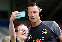 John Terry of Chelsea has his picture taken by a young supporter as he arrives prior to the Premier League match between Swansea City and Chelsea at The Liberty Stadium on September 11, 2016 in Swansea, Wales.