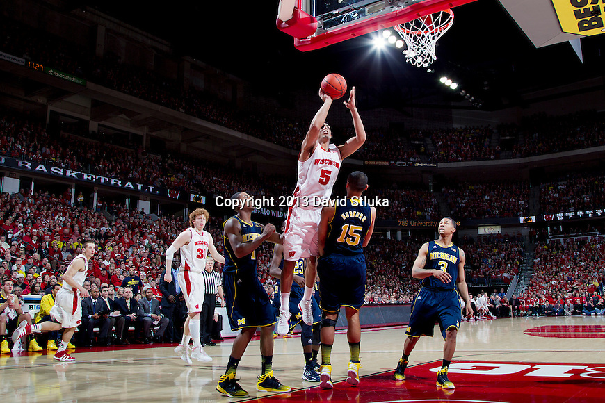 Wisconsin Badgers forward Ryan Evans (5) shoots the ball during a Big Ten Conference NCAA college basketball game against the Michigan Wolverines Saturday, February 9, 2013, in Madison, Wis. The Badgers won 65-62 (OT) (Photo by David Stluka)