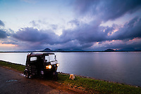 Dambulla, a tuktuk at sunrise, Ibbankatuwa Lake, Central Province, Sri Lanka, Asia. This is a photo of a tuktuk at sunrise at Ibbankatuwa Lake (Ibbankatuwa Wewa) in Danbulla, Central Province, Sri Lanka, Asia.