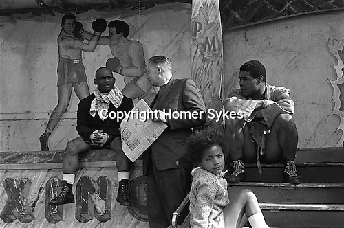 Pat McKeowen's fairground boxing booth show, at the annual Derby horse race Epsom Down, Surrey, England 1969.<br />