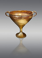 Mycenaean gold goblet with two handles ening with a dogs head biting the rim,  Acropolis Treasure of Mycenae, Greece, National Archaeological Museum of Athens.  This goblet was found as part of a hoard looted in antiquity from Grave Circle A and buried outside the enclosure. 15th century BC