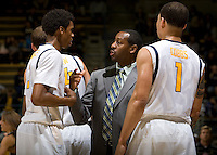 California assistant coach Travis DeCuire talks with Tyrone Wallace during the game against Coppin State at Haas Pavilion in Berkeley, California on November 8th, 2013.    California defeated Coppin State, 83-64.