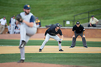 Jake Mueller (6) of the Wake Forest Demon Deacons keeps his eye on West Virginia Mountaineers pitcher BJ Myers (33) as he takes his lead off of first base during Game Six of the Winston-Salem Regional in the 2017 College World Series at David F. Couch Ballpark on June 4, 2017 in Winston-Salem, North Carolina.  The Demon Deacons defeated the Mountaineers 12-8.  (Brian Westerholt/Four Seam Images)