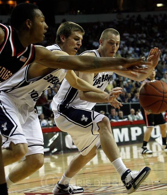 Las Vegas, Nevada --3/14/08--.BYU's Chris Collinsworth, #41, and Chris Miles, #54, chase after a loose ball againt San Diego State's Billy White, #32,  during the first half of the game at the Thomas & Mack Center.  ..************.Mountain West Conference basketball Tournament. .Photo by Chris Detrick/The Salt Lake Tribune..
