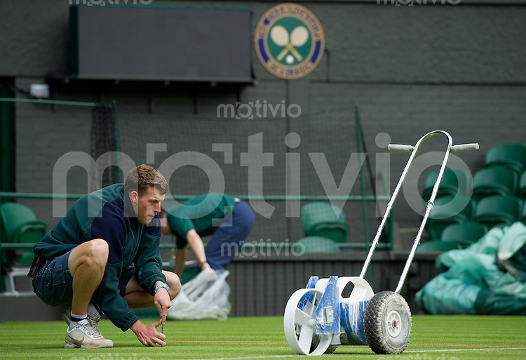 Ground staff prepare Centre Court Line painting on Centre Court Preparation for The Wimbledon Championships 2010 The All England Lawn Tennis & Croquet Club  Saturday Pre Championships Saturday 18/06/2010