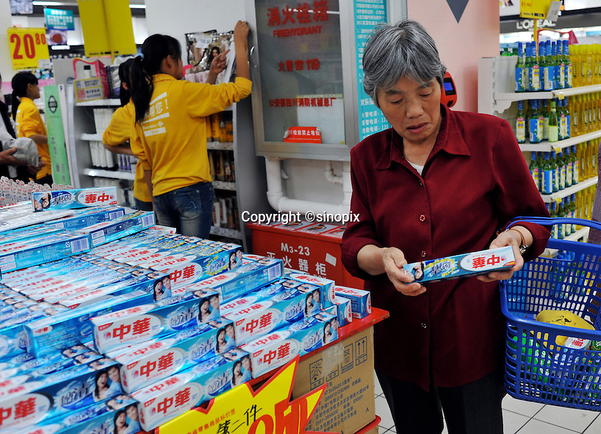 A customer buying Zhong Hua toothpaste in a Carrefour supermarket in Kunming, China. Carrefour plans to open 28 new stores in China this year and the company predicts sales to increase more than 15 percent. Carrefour currently operates more than 130 stores in China. Last year, the retailer opened 22 new stores in the country.