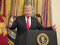 United States President Donald J. Trump concludes his remarks at the Congressional Medal of Honor Society Reception in the East Room of the White House in Washington, DC on Wednesday, September 12, 2018.<br /> CAP/MPI/RS<br /> &copy;RS/MPI/Capital Pictures